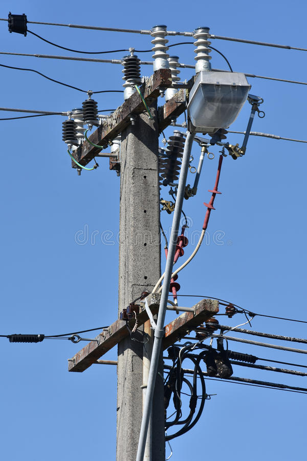 Electric pole with wires and isolators stock images