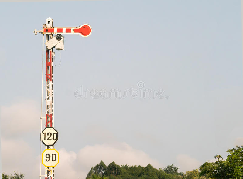 Electric poles with label sign limited speed. Of train stock images