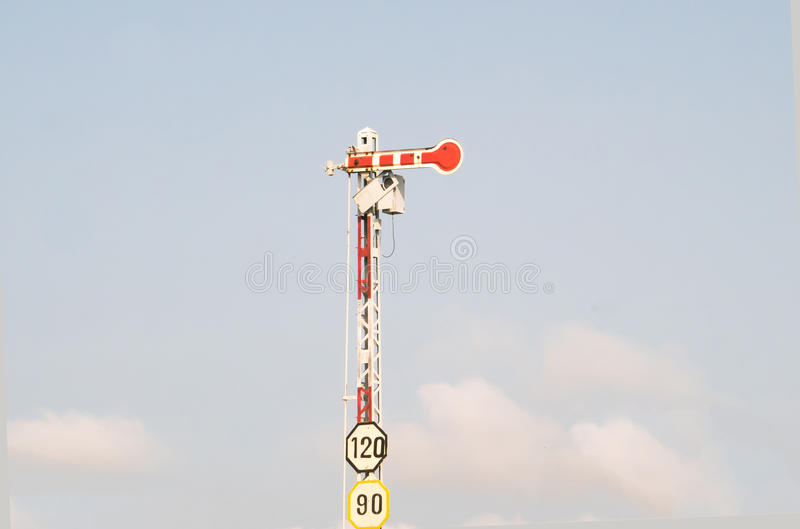 Electric poles with label sign limited speed. Of train royalty free stock photo