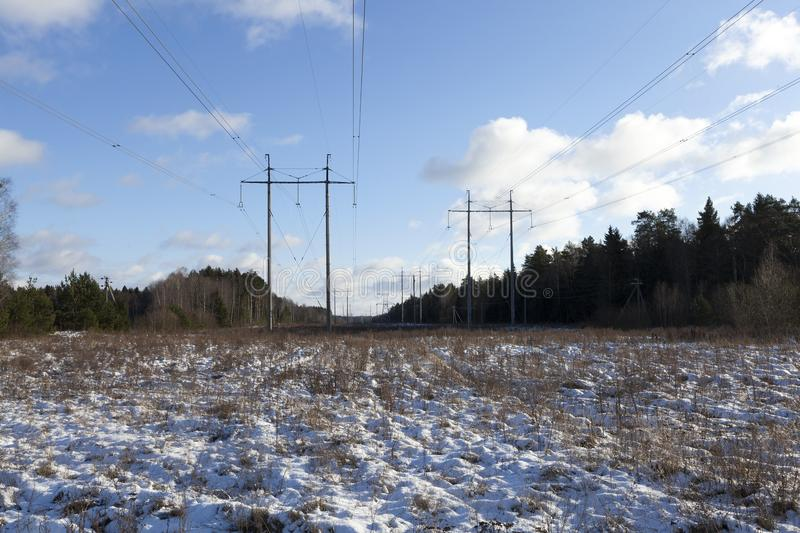 Electric poles, winter stock images