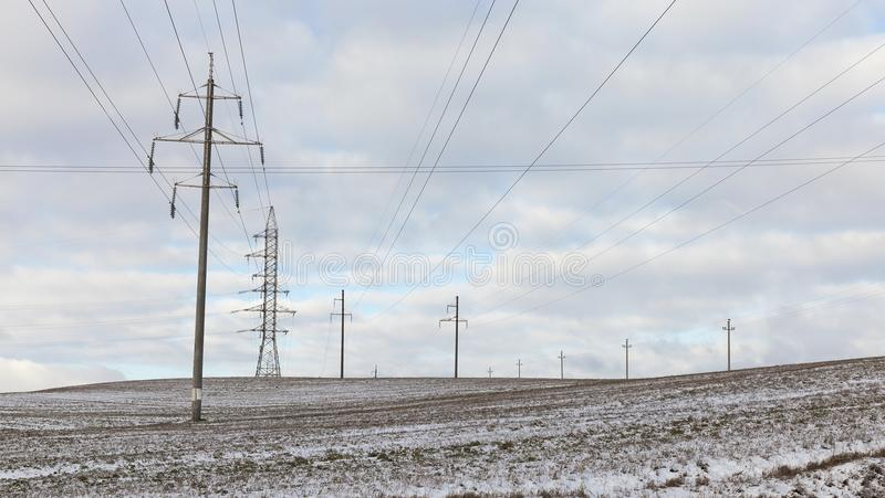 Electric poles, winter royalty free stock image