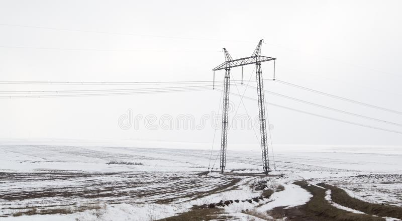 Electric poles in winter outdoors stock photography