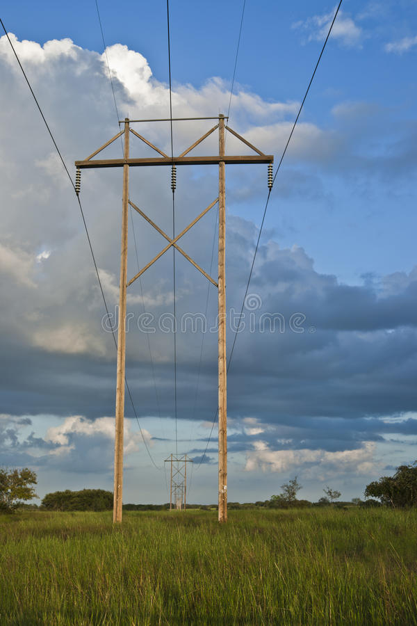 Electric post infinite. A infinite view of electrical post at late evening stock image
