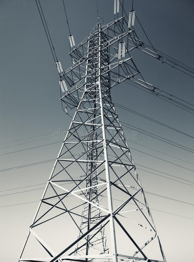 Electric power line. Blue and yellow tint stock photo
