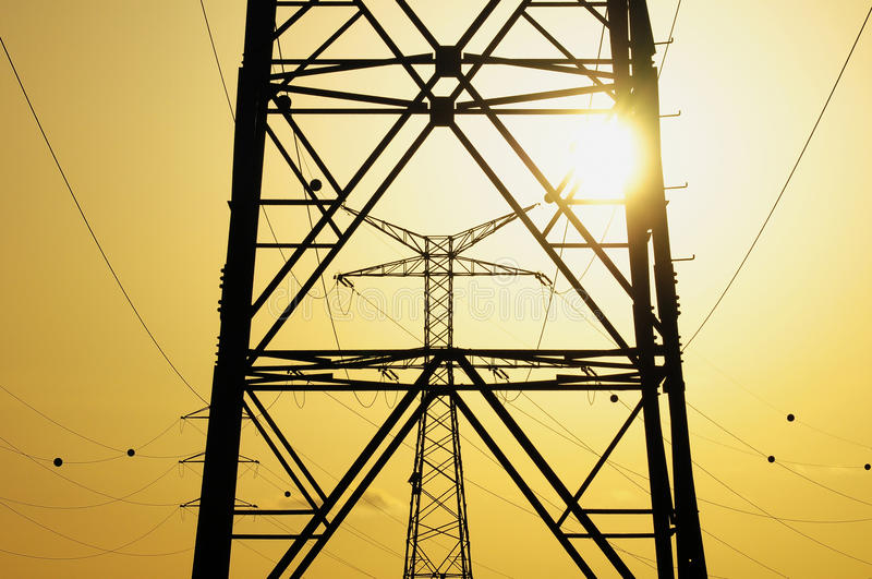 Electric Power Line Pylon. Over a colored Sunset royalty free stock photos