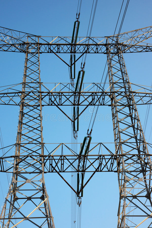 Electric power line and tower. Tall electric power transmission line and tower royalty free stock photos