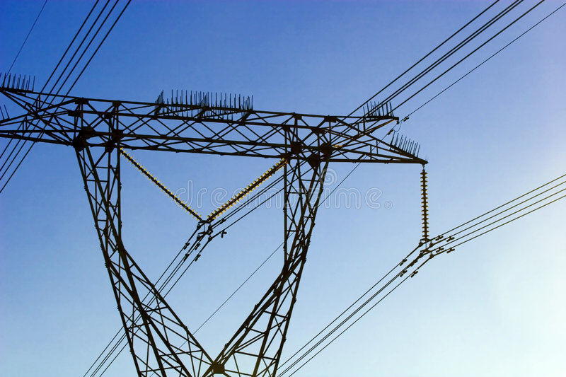 Electric power lines against blue clear sky royalty free stock photos