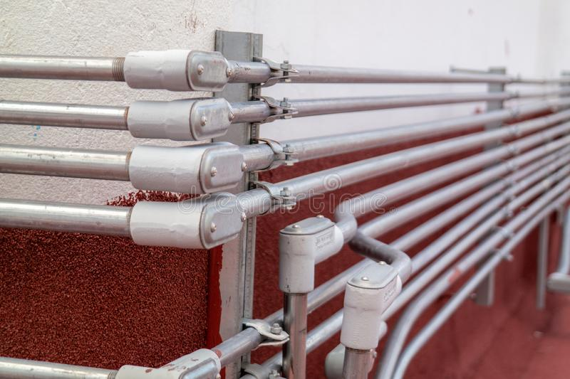 Electric power lines tubes installation stock photos