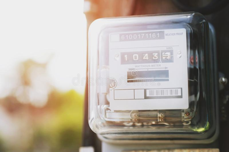 Electric power meter measuring power usage. Watt hour electric meter measurement tool at pole, outdoor electricity for use in home. Appliance monitor the home`s royalty free stock images