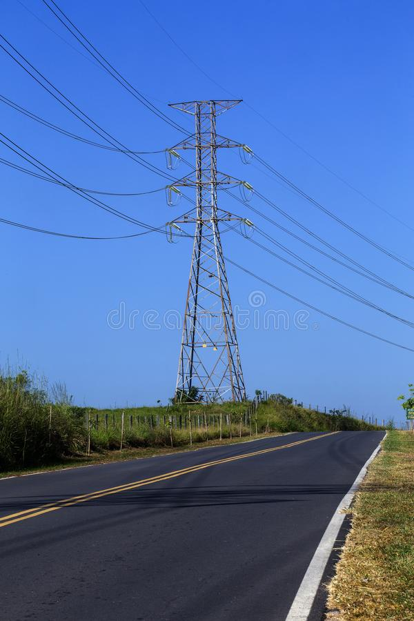 Electric power towers on the highway royalty free stock images