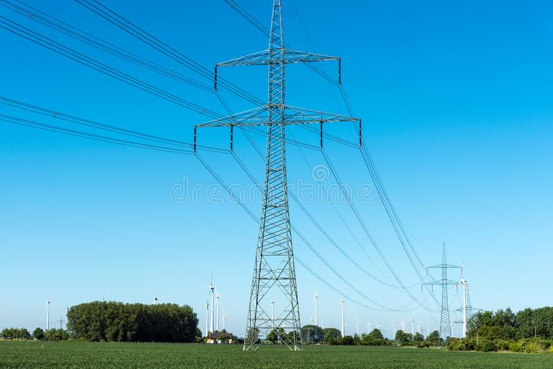 Electric pylons and power transmission lines royalty free stock photo