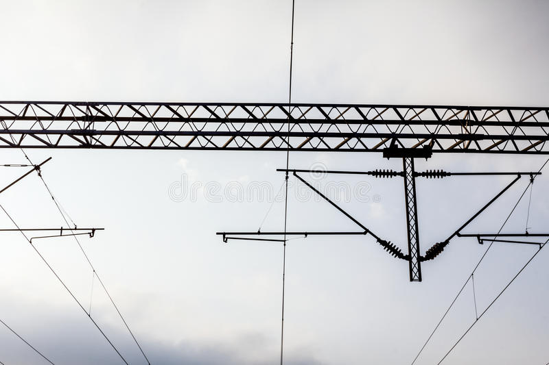 Electric Railways with overhead power line. Electric holders on railway transmission line with a blue sky royalty free stock photo