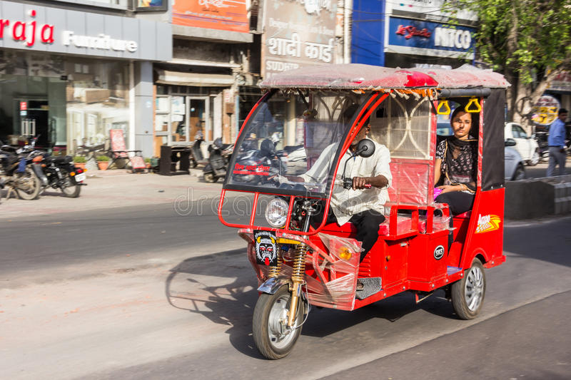 Electric rikshaw. An electric powered motor rikshaw at Karnal, India. Electric rikshaws are rapidly getting more numerous in India stock photography