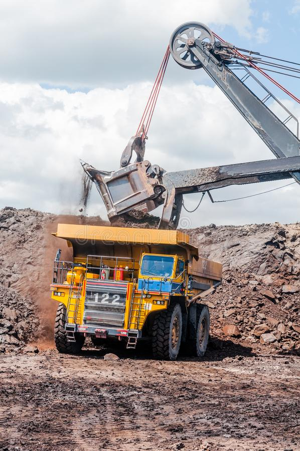 Electric rope shovels loading of coal, ore on the dump truck. Th stock images
