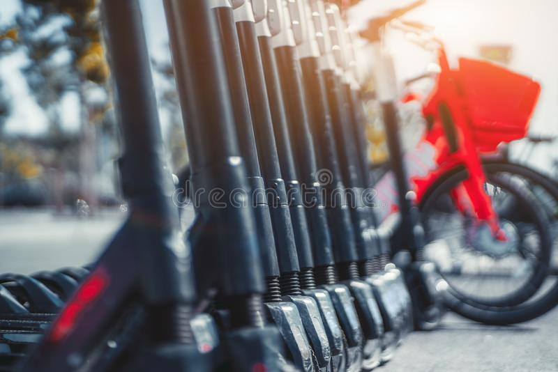 Electric scooters and bicycles stock images