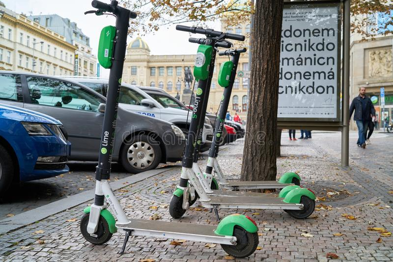 Electric Scooters from the company Lime in Prague. Electric Scooters from the company Lime on the roadside in downtown Prague royalty free stock photography