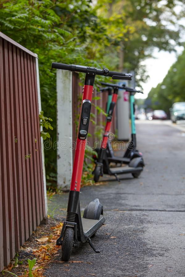 Electric scooters parked across the street. royalty free stock photo