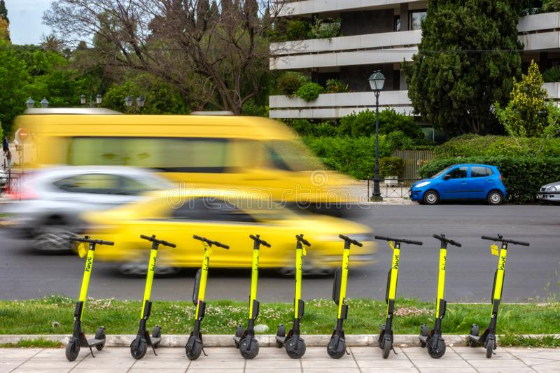 Electric scooters parked in sidewalk royalty free stock images
