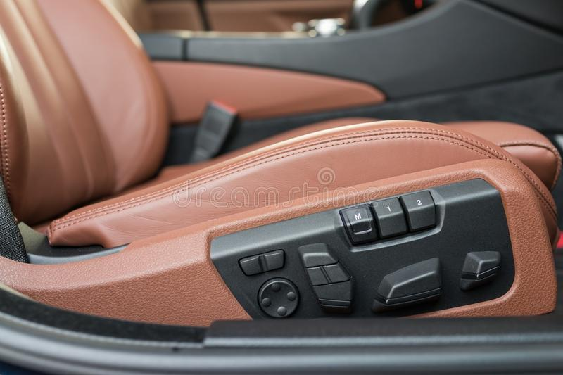 Electric seat adjustment. Detail of a car seat buttons stock images