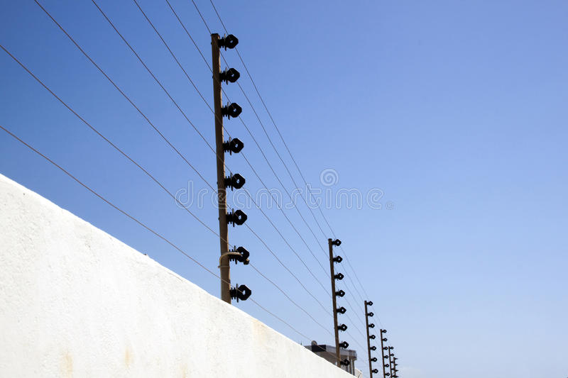Electric Security Fence on Top Of Boundary Wall stock images