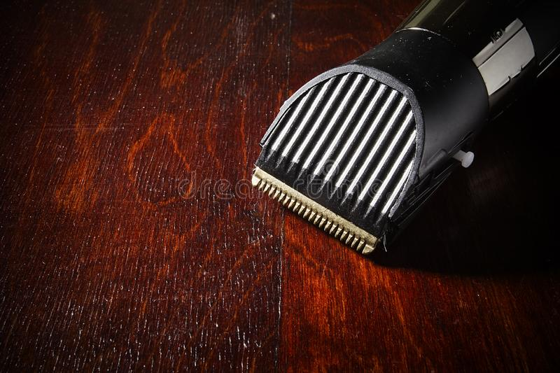 Electric shaver on the table. Electric shaver on wooden table close up stock photos