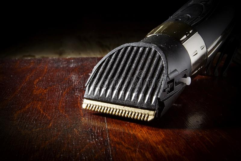 Electric shaver on the table. Electric shaver on wooden table close up stock images