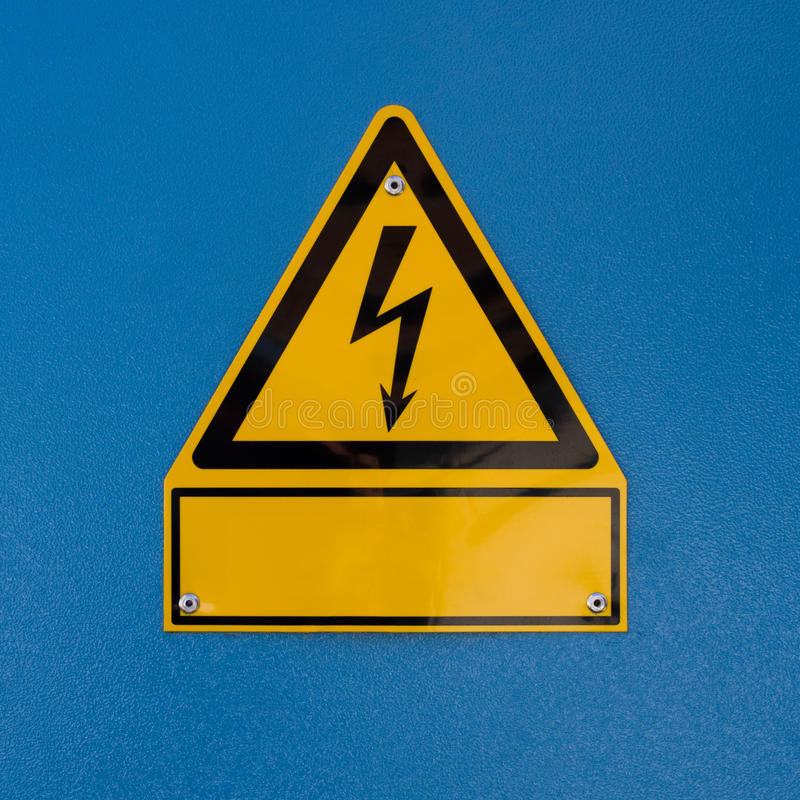 Electric shock hazard sign. A sign for high voltage with an empty space for text stock photography