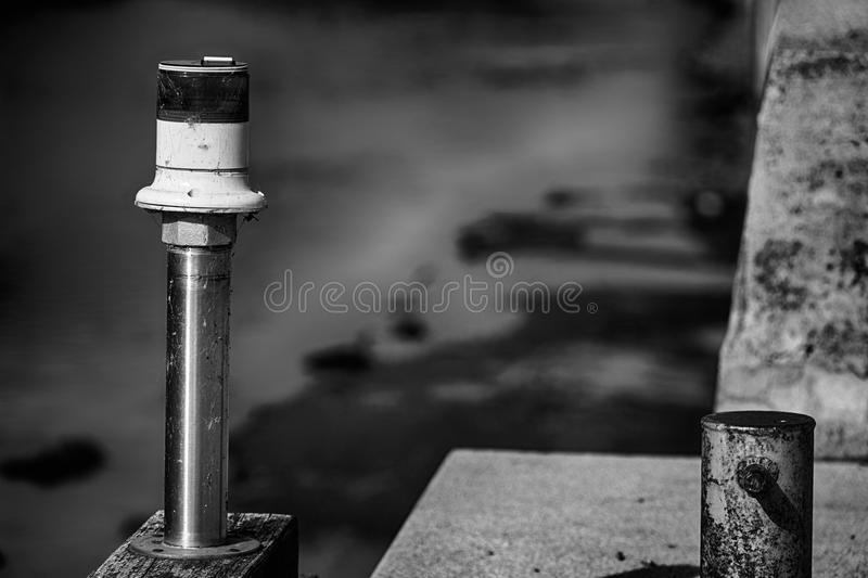 Electric signal lantern on the river water canal, beacon for the boats.  stock photos