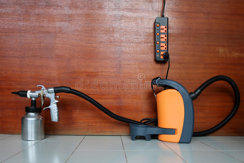Electric sprayer with wooden wall. Electric sprayer for industries with wooden wall royalty free stock photo