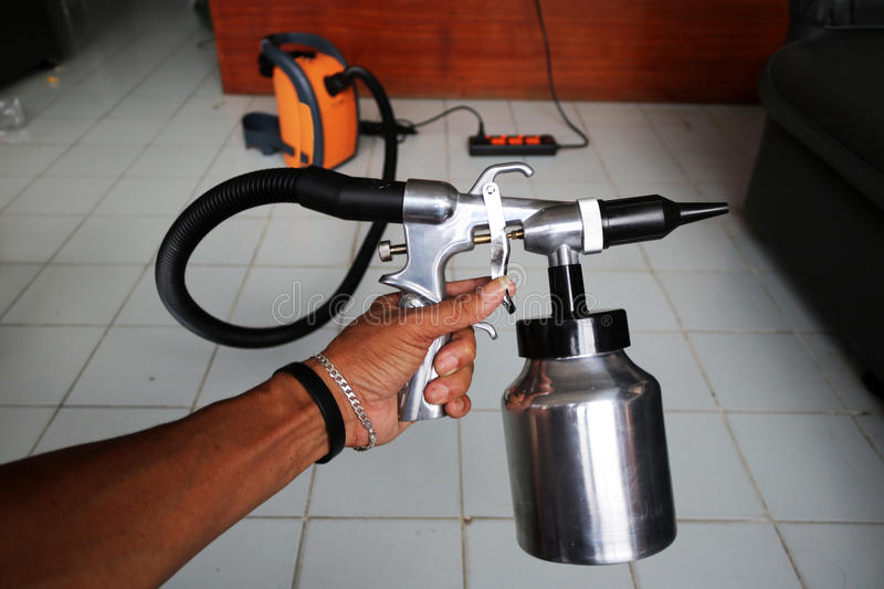 Electric sprayer with wooden wall. Electric sprayer for industries with wooden wall stock photography