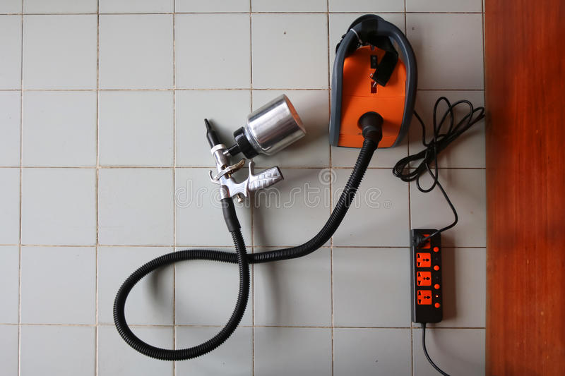 Electric sprayer with wooden wall. Electric sprayer for industries with wooden wall royalty free stock image