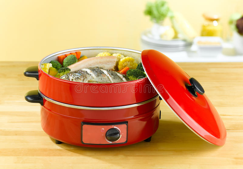 Electric steaming cooking pot stock photos