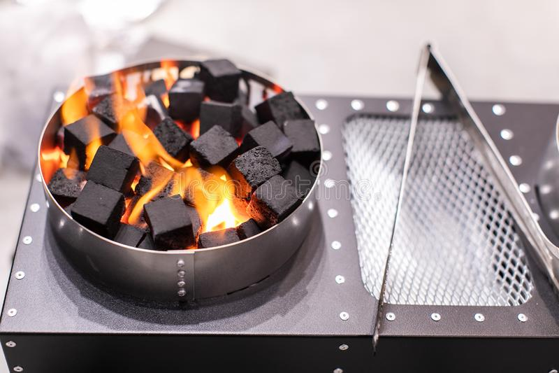 Electric Stove For Ignition Of Coals For Shisha Glowing royalty free stock images