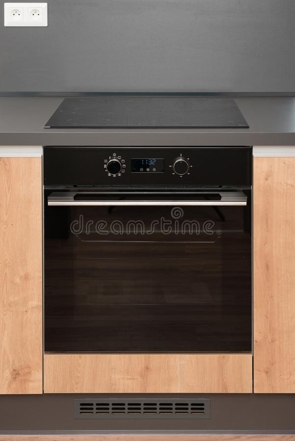 Electric stove with induction cooktop. New electric stove with induction cooktop in contemporary kitchen royalty free stock photos