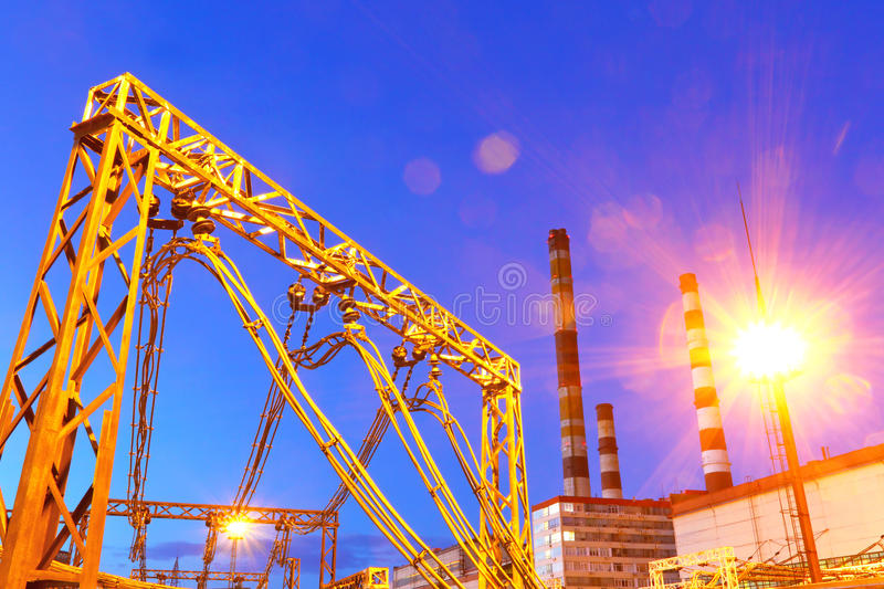 Electric substation in night-time lighting stock images