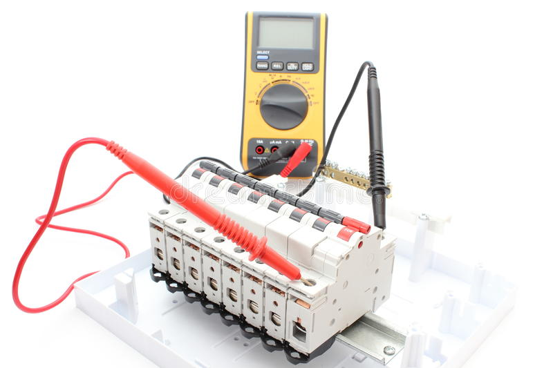 Electric switch on the control panel and multimeter. Electric switch on the control panel with multimeter stock photo