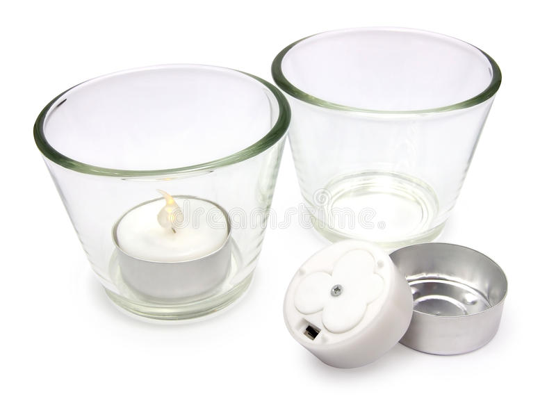 Electric tealight candles. Two electric tealight candles in glass candle holders isolated on the white background royalty free stock images