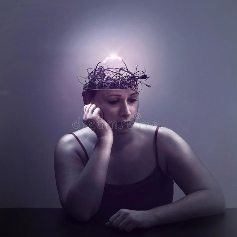 Electric thoughts. A woman lost in thought as her mind is filled with electric wires royalty free stock photos