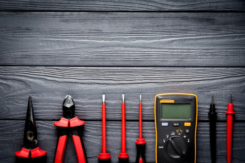 Electric tools on black wooden backdrop stock photos