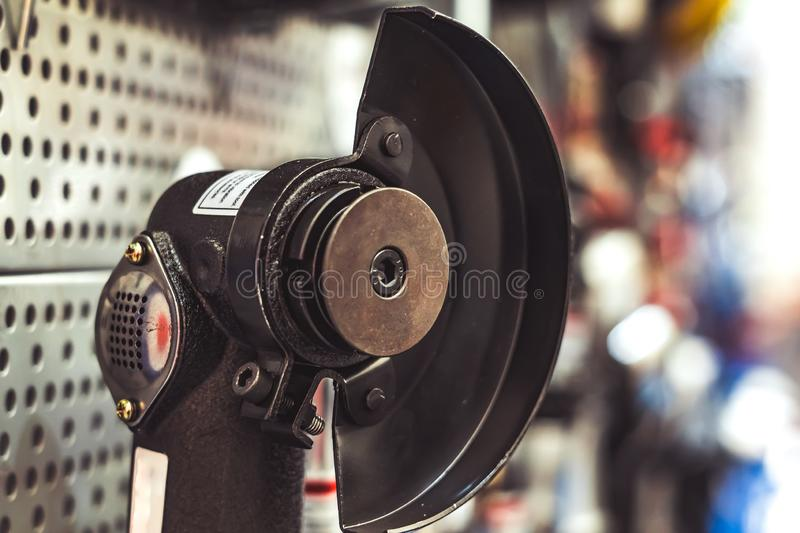 Tool on the stand. Electric tools for construction on the stand in the shop royalty free stock images