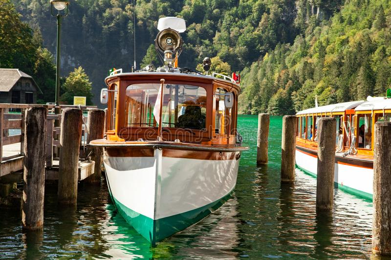 Electric tourist boats on beautiful lake Konigssee pier Berchtesgaden National Park Germany royalty free stock images