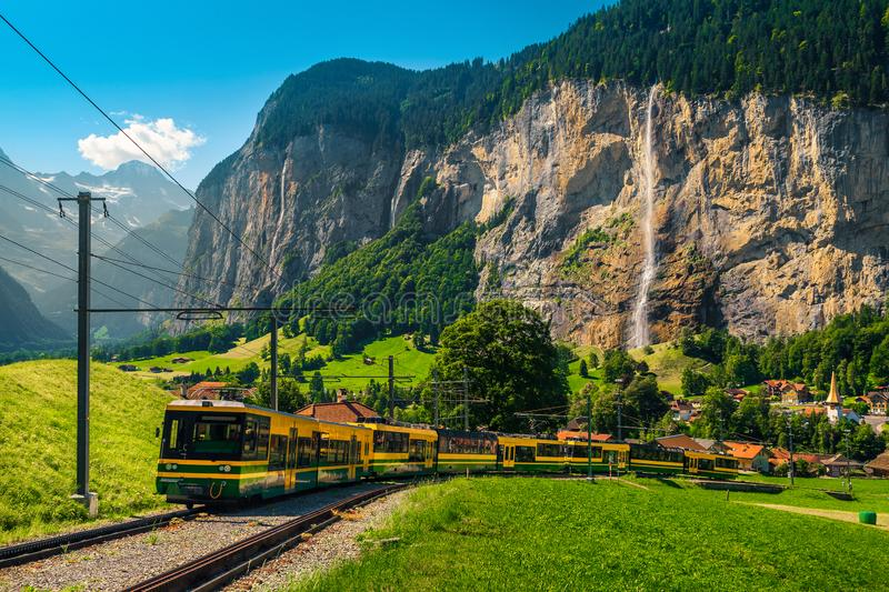Electric tourist train and Lauterbrunnen village in background, Switzerland royalty free stock images