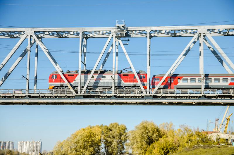 The electric train crosses the Ob river. Transsiberian railway stock photos