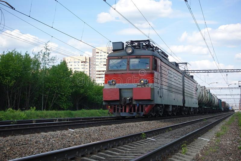 Electric train with a train in Russia. Summer day.  royalty free stock images