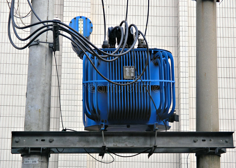 Electric transformer in blue royalty free stock photography