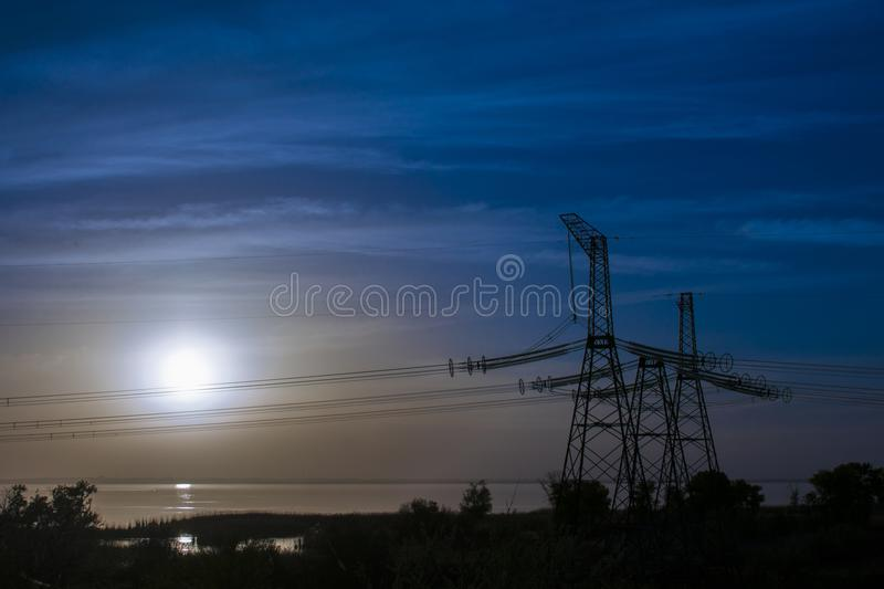 Electric transmission line on a colorful sunset.  stock image