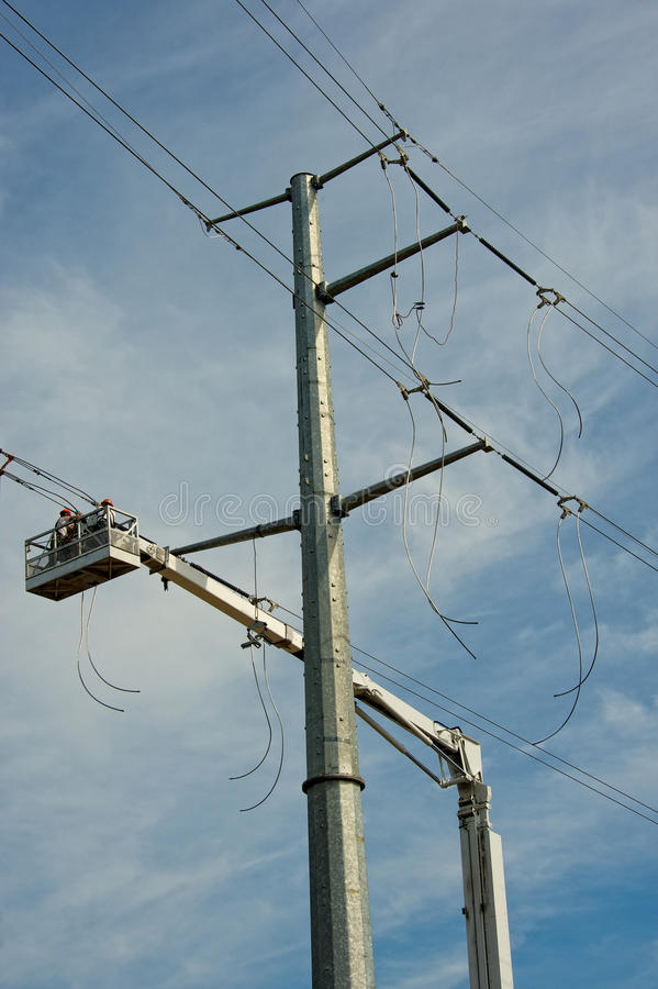 Electric Transmission Line Construction. Vertical photo of new electric transmission line being constructed stock image