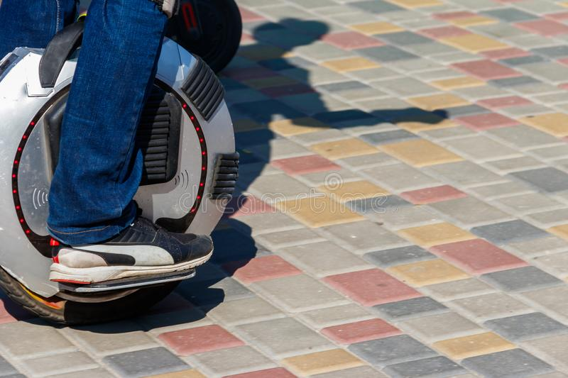 Electric unicycle. Man rides on mono wheel in park stock images