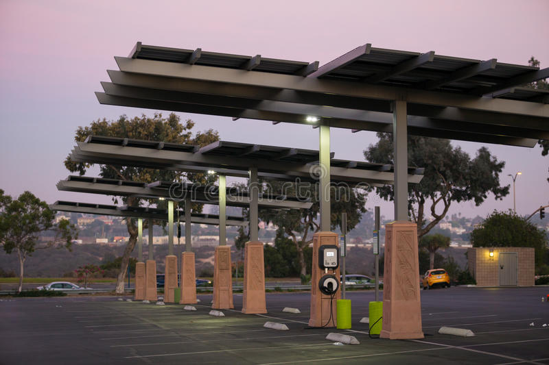 Electric Vehicle Charging Station California. SAN DIEGO, CA - JANUARY 29, 2014: Solar powered electric vehicle car charging station in a public parking lot in royalty free stock photo