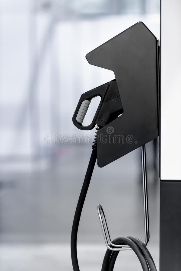 Electric vehicle charging station with plug of power cable supply for Ev car. stock image